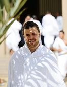 Muslim wearing ihram clothes and ready for Hajj poster