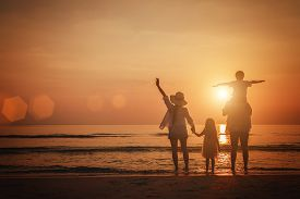 Summer Vacation, Happy Family  Together On The Beach In Holiday.