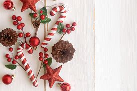 Christmas White Wood With Pine Cones Or Conifer Cone, Red Holly Balls, Glitter Star, Candy Cane And