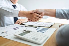Businessman Shaking Hands After Conversation, Finishing Up A Collaboration Discussing Of Partner Coo