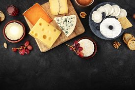 Cheese Assortment With Copy Space, A Flat Lay Overhead Shot On A Dark Background With A Place For Te