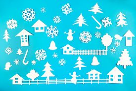 Christmas Theme Figures Made Of White Paper On Blue Background