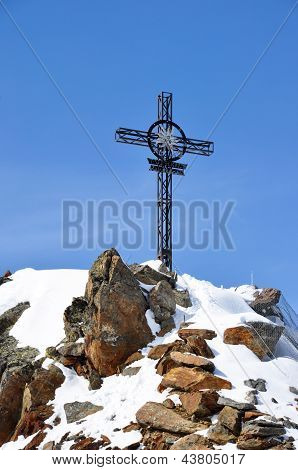 Iron cross on the top of the Gaislachkogl mountain near Solden in the Zillertal Alps in Austria poster