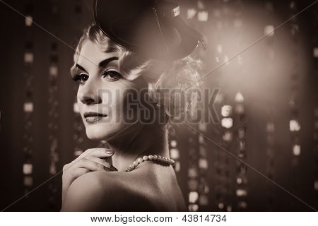 Toned picture of  elegant blond retro woman   wearing little hat