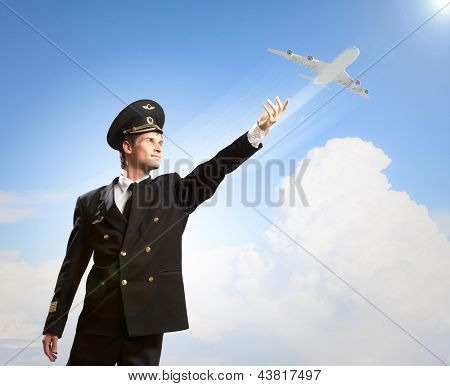 Image of pilot touching sky against airplane background poster