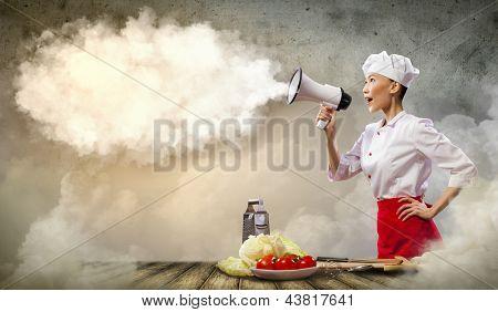 Asian female cook screaming loud in megaphone