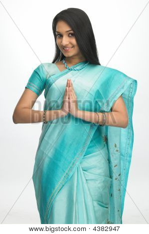 Young Girl In Sari With Welcome Posture