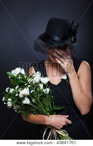 sad widow crying at husband's funeral poster