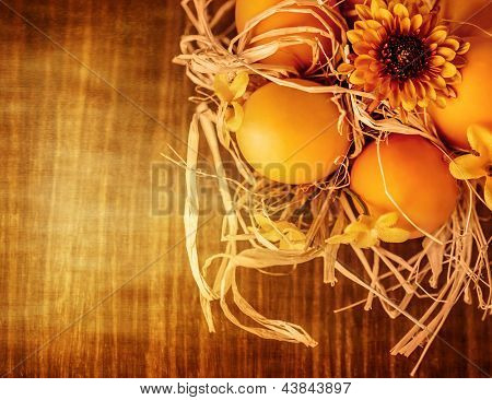 Beautiful Easter still life, chicken eggs in dry nest on wooden table, traditional Christian Eastertime symbol