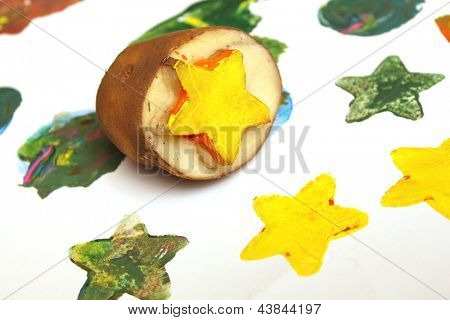 Making homemade stamps from potatoes