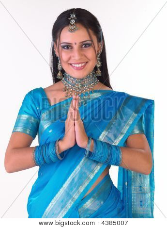 Girl In Blue Sari With Greetings Expression