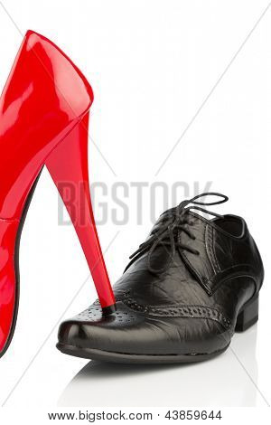 ladies shoes on men's shoe, symbol photo for separation, divorce and conflict
