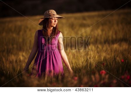 Young girl with closed eyes on field