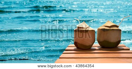 Romantic cocktail of coconuts on the bridge for swimming