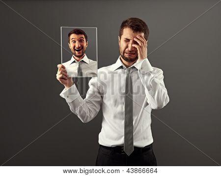 hypocritical man hiding his gladness