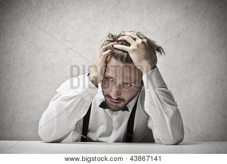 desperate man with hand in the hair