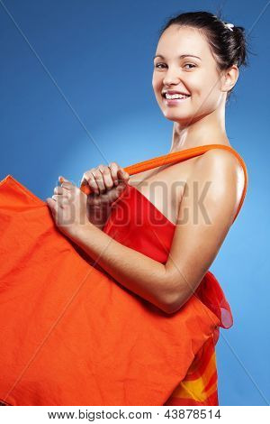 Beautiful young woman wearing big summer bag studio series