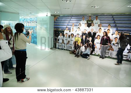 MADRID - MARCH 8: Fans are photographed near to photo Real Madrid in Santiago Bernabeu stadium on March 8, 2012 in Madrid, Spain. Real Madrid is best football club in XX century, according to FIFA.