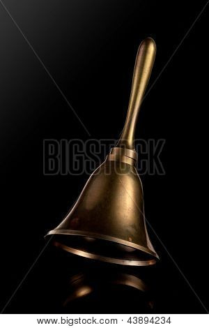 Hand Bell isolated on a black background