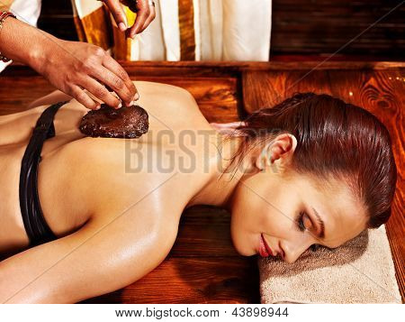 Young woman having body Ayurveda spa massage.