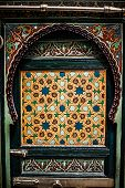 Detail of the beautiful tile mosaic decoration of the at Fez Morocco. poster