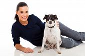 cute pet dog with its female owner relaxed poster
