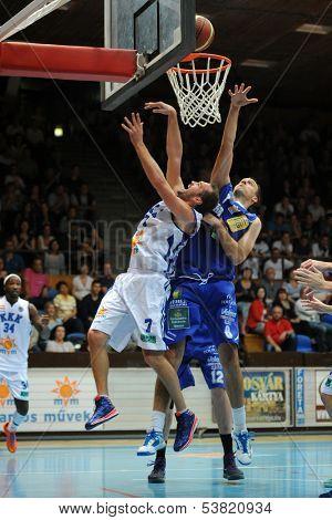 KAPOSVAR, HUNGARY � OCTOBER 26: Hrvoje Puljko (in white) in action at a Hungarian Championship basketball game with Kaposvar (white) vs. Fehervar (blue) on October 26, 2013 in Kaposvar, Hungary.