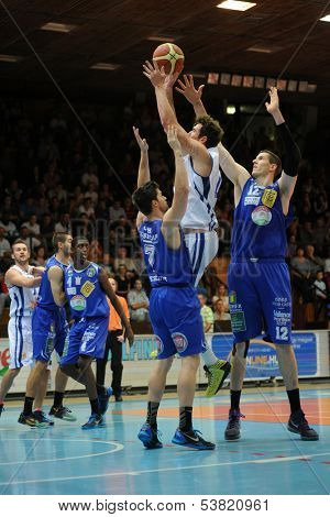 KAPOSVAR, HUNGARY � OCTOBER 26: Roland Hendlein (white 11) in action at a Hungarian Championship basketball game with Kaposvar (white) vs. Fehervar (blue) on October 26, 2013 in Kaposvar, Hungary.
