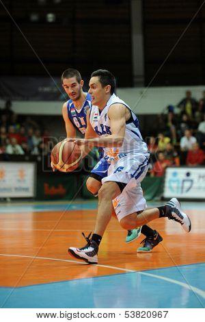 KAPOSVAR, HUNGARY � OCTOBER 26: Kornel Kiss (in white) in action at a Hungarian Championship basketball game with Kaposvar (white) vs. Fehervar (blue) on October 26, 2013 in Kaposvar, Hungary.