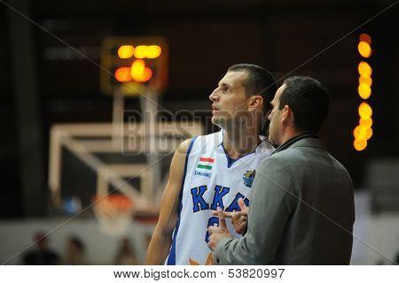 KAPOSVAR, HUNGARY � OCTOBER 26: Marton Fodor (in white) in action at a Hungarian Championship basketball game with Kaposvar (white) vs. Fehervar (blue) on October 26, 2013 in Kaposvar, Hungary.