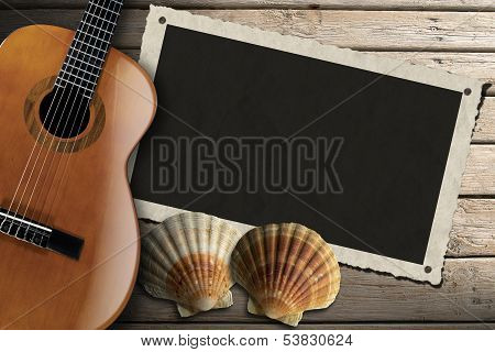 Guitar And Photo Frame On Wood Boardwalk