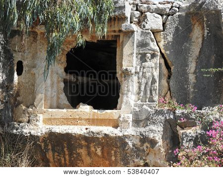 Rock tomb in the ancient city of Teimiussa with bas-relief.