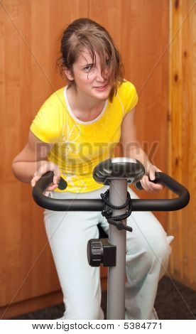 Girl Exercising At Exercycle