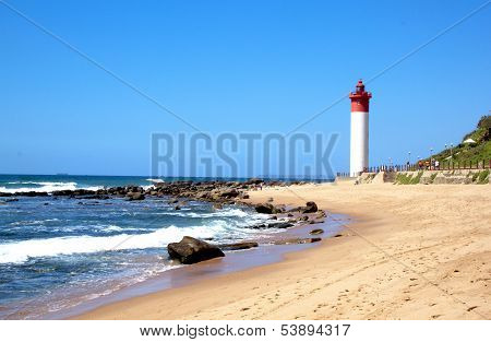 Coastal Seascape With Red And White Lighthouse