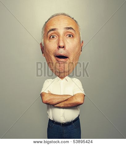 funny picture of amazed bighead man over grey background