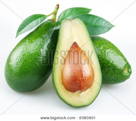 Avocado and cut in half avocado with leaves