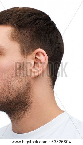 health and body parts concept - close up of male ear