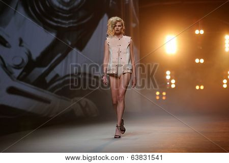 Fashion model wears clothes made by Tatjana Pantos on