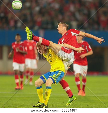 VIENNA,  AUSTRIA - JUNE  7 Marc Janko (#21 Austria) and Rasmus Elm (#6 Sweden) fight for the ball during the world cup qualifier game on June 7, 2013 in Vienna, Austria.