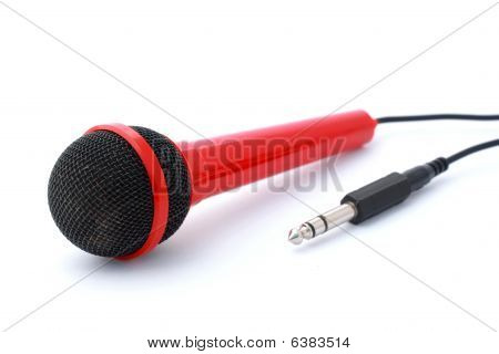 Red Microphone With Plug And Cable  Isolated On White With Copyspace