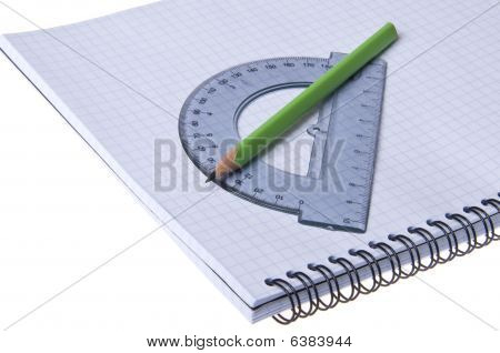 Protractor And Pencil On Copybook