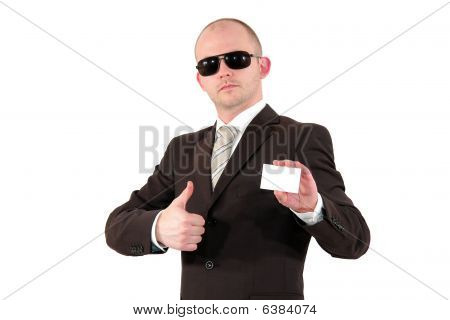 young business man with sunglasses showing a business card and posing with thumbs up