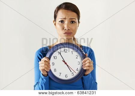 Asian Girl Holding Big Blue Clock With Stress