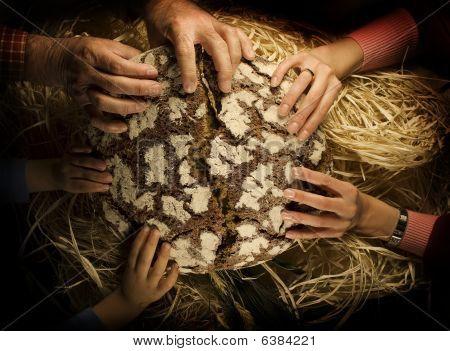 people sharing bread