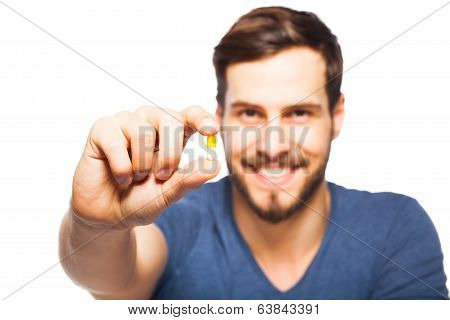 Handsome Man Showing Pills