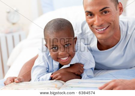 A Father And His Boy Reading A Book