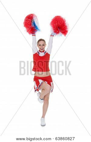 Young Cheerleader Holding Pom-poms