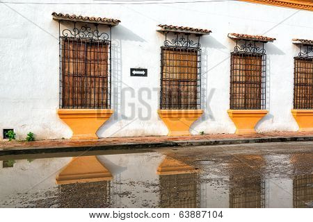 Colonial Facade And Reflection