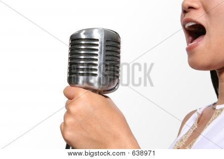 Singing (Focus On Microphone)