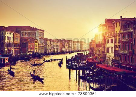 Venice, Italy. Gondolas on Grand Canal, Italian Canal Grande at gold sunset. View from Rialto Bridge. Vintage, retro style